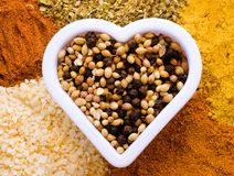 Mixed spices with heart shape stock photography