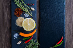 Mixed spices and herbs with lemon. Copyspace, top view. Royalty Free Stock Photography