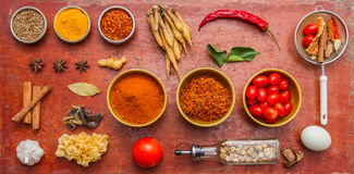 Mixed spices and herbs on red background. Stock Image
