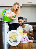 Mixed spouses doing regular laundry Royalty Free Stock Images