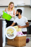 Mixed spouses doing regular laundry Stock Photography
