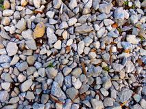 Mixed stones, pebbles and rocks texture royalty free stock photography