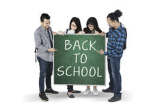 Mixed Students Show Text Of Back To School Royalty Free Stock Image