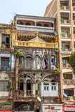 Mixed styles. YANGON, MYANMAR - MAR 1: Building in the city center with mixed styles from colonial and imperial time to modern styles and materials on Mar 1 stock image