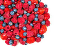 Mixed summer berries isolated on white background. Blueberries, strawberries, raspberries Royalty Free Stock Photo