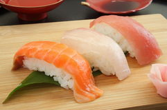 Mixed Sushi Platter on wooden plate with Sake, Japanese Food Stock Photography