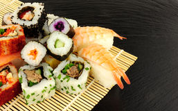 Mixed Sushi Rolls On A Slate Background Stock Images