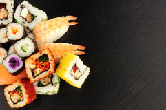 Mixed Sushi Rolls On A Slate Background Royalty Free Stock Photo