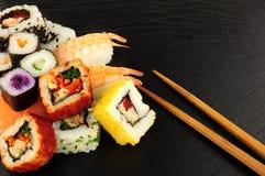 Mixed Sushi Rolls On A Slate Background Royalty Free Stock Image