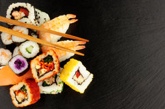 Mixed Sushi Rolls On A Slate Background Royalty Free Stock Images