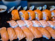 Mixed sushi bar set. Salmon, shrimp, makizushi royalty free stock image