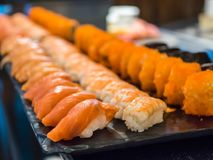 Mixed sushi bar set. Salmon, shrimp, makizushi royalty free stock photo