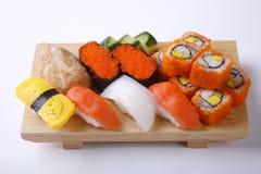 Mixed sushi set on wooden tray isolated on white background Stock Photos