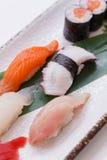 Mixed Sushi such as Hamachi, Salmon, Squid and Buri with Salmon Hosomaki.  Stock Photo