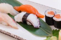 Mixed Sushi such as Hamachi, Salmon, Squid and Buri with Salmon Hosomaki.  Stock Photos