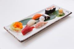 Mixed Sushi such as Toro, Hamachi, Salmon, Squid and Buri with Salmon Hosomaki.  Stock Photos
