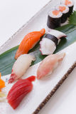 Mixed Sushi such as Toro, Hamachi, Salmon, Squid and Buri with Salmon Hosomaki.  Royalty Free Stock Images