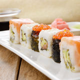 Mixed sushi on a white plate with  soy sauce wasabi and ginger Stock Photos