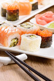 Mixed sushi on a white plate with soy sauce wasabi and  ginger Stock Photo