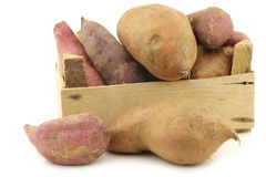 Mixed sweet potatoes in a wooden crate Royalty Free Stock Photos