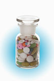 Mixed tablets in bottle, close up Royalty Free Stock Image