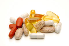 Mixed tablets isolated Royalty Free Stock Photo