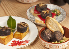Mixed tapas with morcilla. Stock Photography