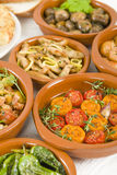 Mixed Tapas. A selection of tapas dishes in traditional bowls Stock Photos