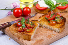 Free Mixed Tomatoes With Basil Bruschetta. Royalty Free Stock Photography - 58912947