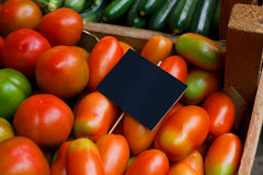 Mixed tomatoes. In a wooden box on display Royalty Free Stock Image