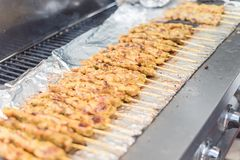 Mixed traditional satay food at Asian market in America. Close-up mixed Satay BBQ at Asian market in Texas, America. It is the Southeast Asian dish of seasoned royalty free stock photography