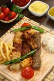 Mixed Turkish Shish kebab on skewers Stock Photos