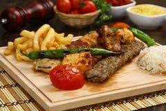 Mixed Turkish Shish kebab on skewers Royalty Free Stock Photography