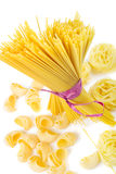 Mixed uncooked raw italian pasta with spaghetti Royalty Free Stock Photography