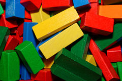 Mixed up colorful wooden toy bricks  or blocks Stock Images