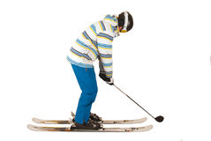 Mixed up young man who can't decide between golf and skiing, fun Stock Photography
