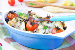 Mixed vegetable in blue bowl baked in the oven with cheese Royalty Free Stock Photography