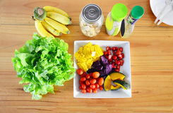 Mixed vegetable and fruit Salad. This salad have Stawberry, tomato, corn, banana, Green Oak, breads pumkin and sweet potato Boil with Salad dressing Stock Photos