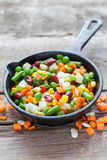 Mixed vegetable meal in old frying pan and ingredients Royalty Free Stock Photo