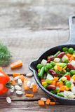 Mixed vegetable meal in old iron frying pan closeup Royalty Free Stock Photos