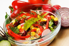 Mixed vegetable salad. Served in a glass bowl Stock Image