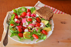 Mixed vegetable salad with crab sticks and avocado Stock Image
