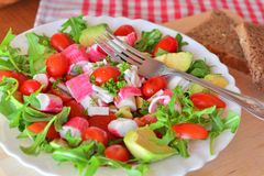Mixed vegetable salad with crab sticks and avocado Stock Images