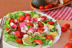 Mixed vegetable salad with crab sticks and avocado Stock Photos