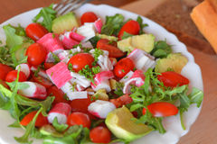 Mixed vegetable salad with crab sticks and avocado Royalty Free Stock Image