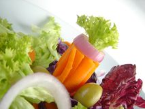 Mixed vegetables. Carrot, lettuce, onion, olive and other vegetables in a salad Royalty Free Stock Image