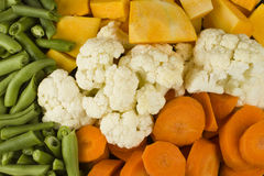Mixed vegetables. Mixed raw uncooked green beans, collyflower, pumpkin and carrots Royalty Free Stock Photography