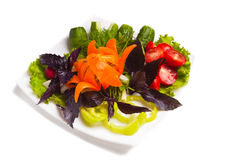 Mixed vegetables. On a white background on a plate lined with Stock Photography