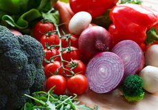 Mixed vegetables. Bunch of mixed vegetables on wooden table Stock Image