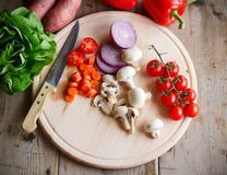 Mixed vegetables. Bunch of mixed vegetables on wooden table Stock Photo